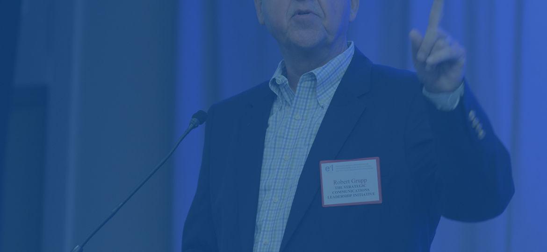 Robert Grupp announcing the strategic communication conference agenda